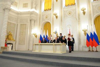 Подписание Договора между Российской Федерацией и Республикой Крым о принятии в Российскую Федерацию Республики Крым и образовании в составе Российской Федерации новых субъектов.